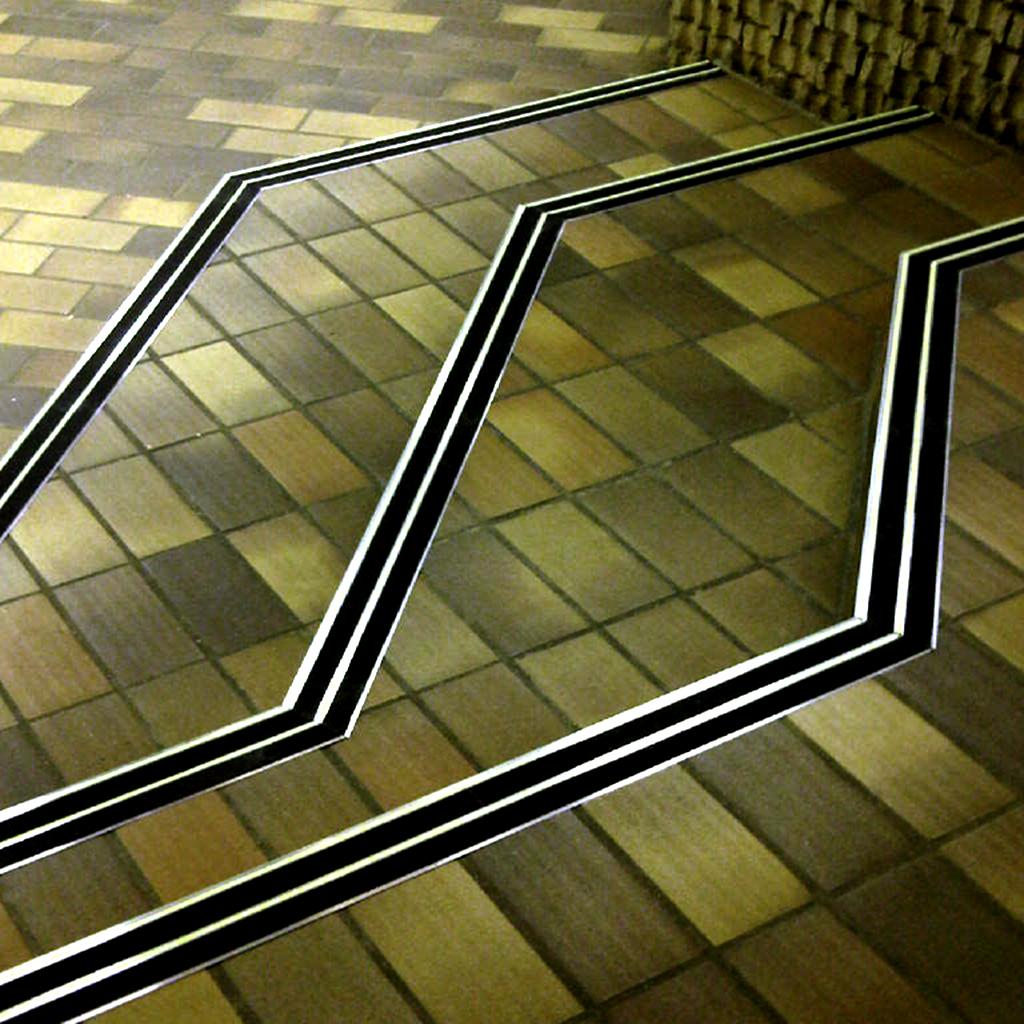 FibreGrip non-slip double aluminium stair nosing with LumiGlo on staircase at UPTA