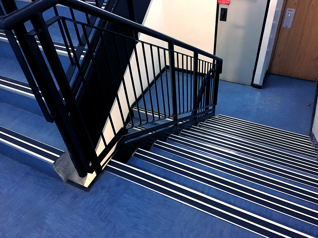 FibreGrip non-slip double aluminium stair nosing with LumiGlo on staircase at RMB